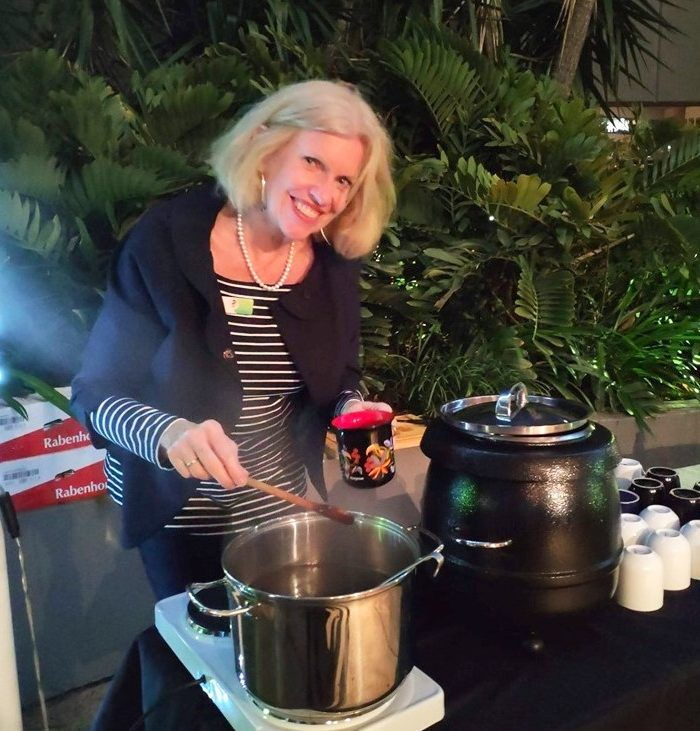Louise making winter Gluehwein at a function